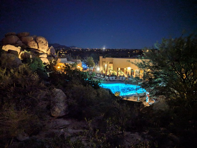 Night view of The Boulders pool and lodge
