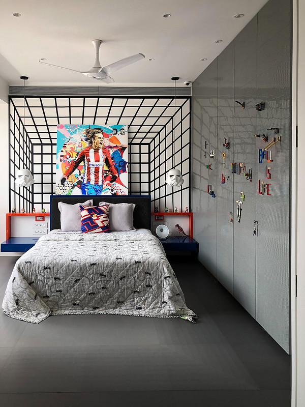 A 3-D wallpaper and lego blocks as wardrobe shutters