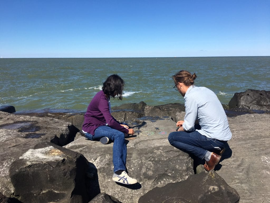 City and regional planning students sketch by Lake Erie.   photo / Audrey Wachs (M.R.P. '20)