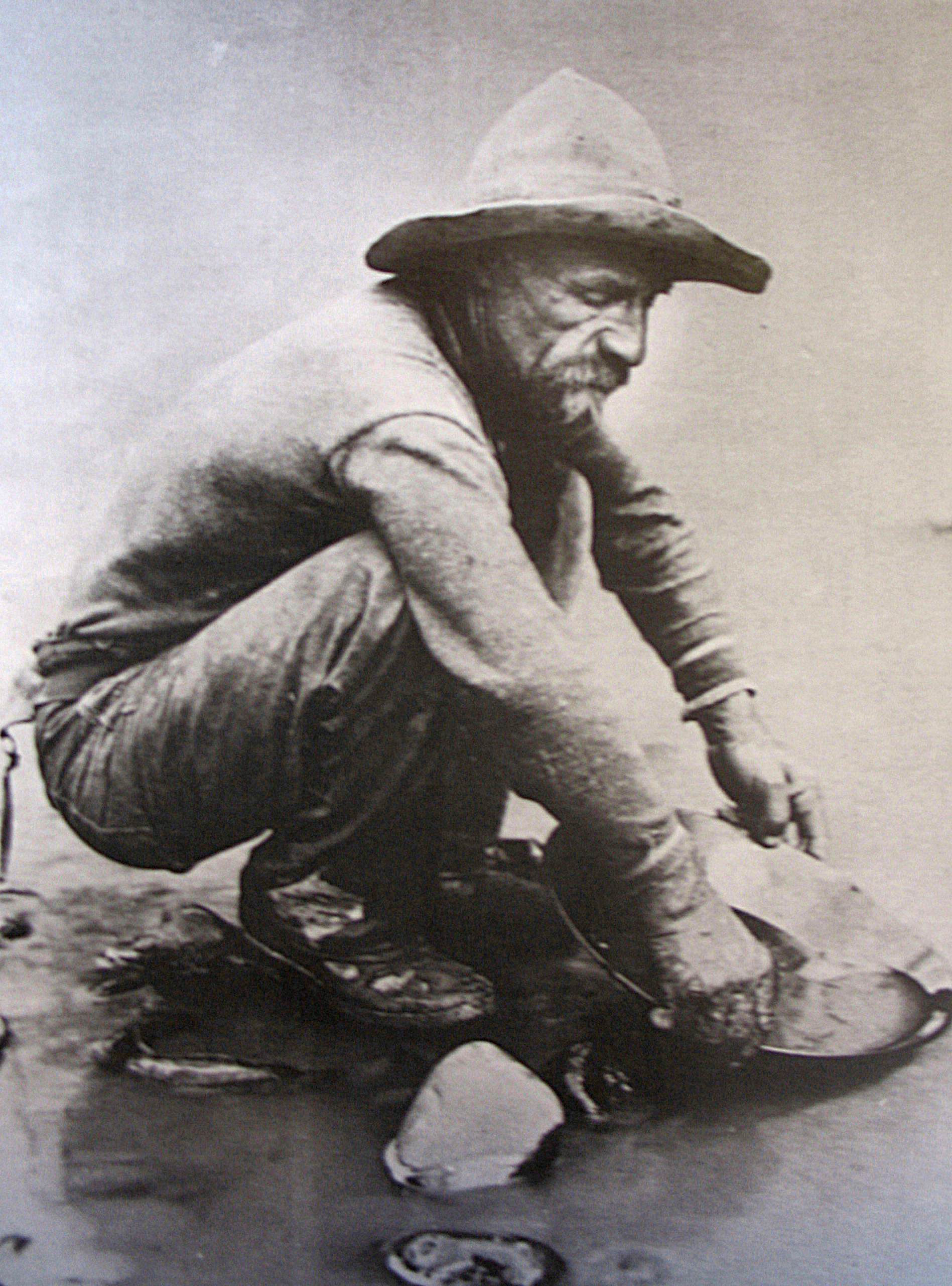 A forty-niner pans for gold on California's American River. Photo taken by L. C. McClure, 1850.