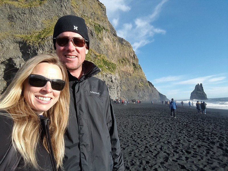 Terry and Claire on a black sand beach in Iceland