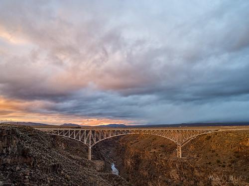 riogrande bridge clouds gorge river storm sunset taos