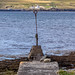 Pointing to the Lighthouse - Thurso across to Scrabster, Scotland. UK.