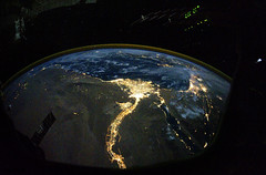 Night time photo featuring the bright lights of Cairo and Alexandria, Egypt on the Mediterranean coast. The Sinai Peninsula, at right, is outlined with lights highlighting the Gulf of Suez and Gulf of Aqaba. Original from NASA. Digitally enhanced by rawpi