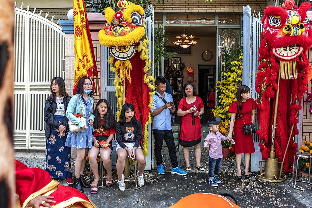 Family that hired dragon and lion dancers--Saigon