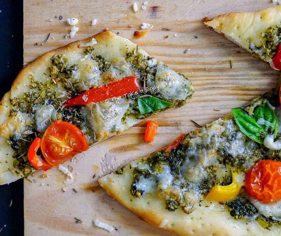 Image of Easy, Home-baked Pesto Pizza - sliced and ready to eat!