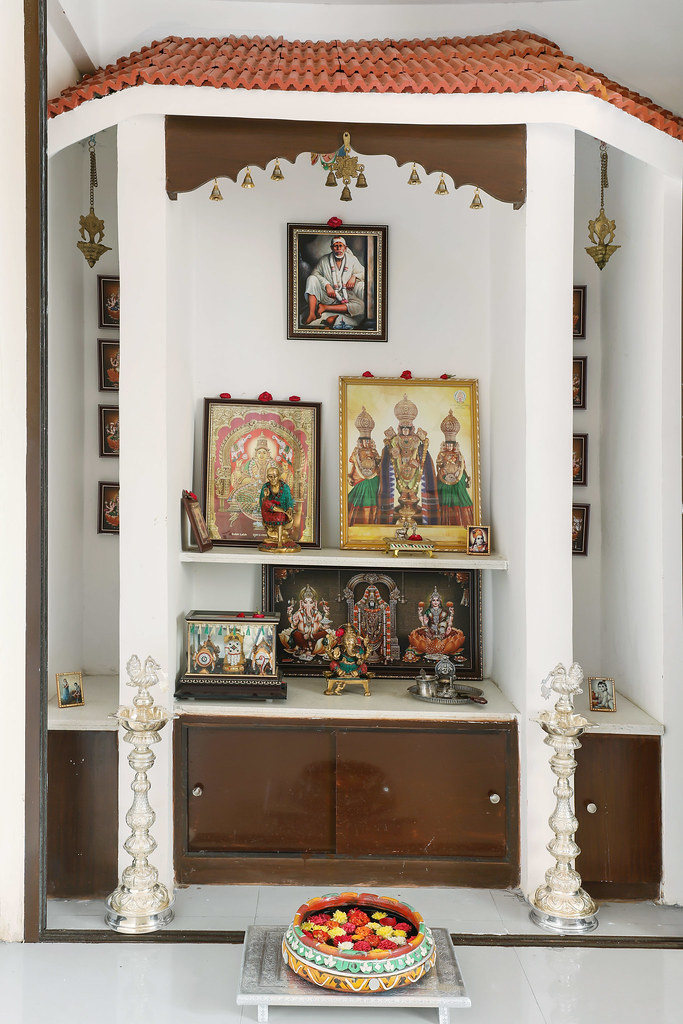 Traditional Pooja room design in an apartment with tiled roof