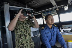 SOUTH CHINA SEA (Nov. 15, 2018) Lt. j.g. Ben Ralen and Lt. j.g. Akmal Japin search for surface contacts on the bridge aboard Military Sealift Command's expeditionary fast transport ship USNS Fall River (T-EPF 4) during tactical maneuvering drills as part of Cooperation Afloat Readiness and Training (CARAT) Brunei 2018. CARAT Brunei 2018 marks the 24th iteration of the maritime exercise series and reflects the growing relationship between the U.S. and Royal Brunei Navy to further expand bilateral and multilateral exercises in cooperatively ensuring maritime security, stability and prosperity. (U.S. Navy photo by Mass Communication Specialist 1st Class Greg Johnson)
