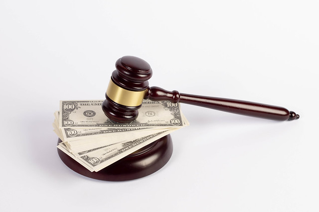 Judge gavel and money on white background