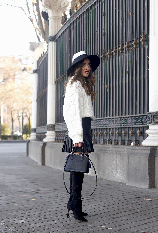 black pleated skirt  white sweater louis vuitton bag street style inspiration 20193