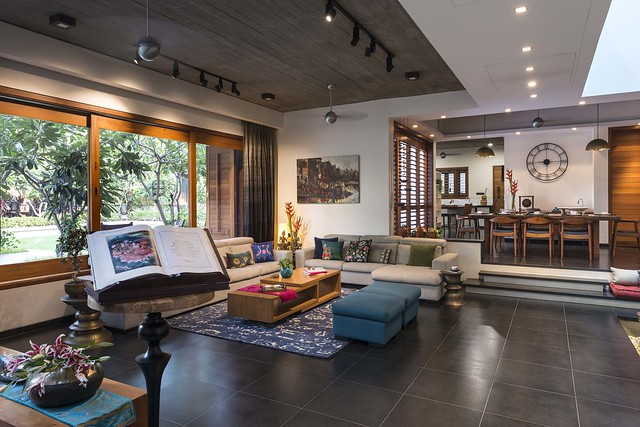 Contemporary dark Living room with strong ethnic influences overlooking the garden