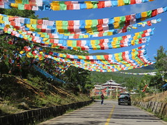 On the road, prayer flags