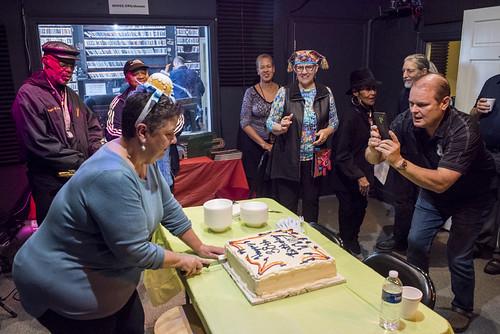 Beth Arroyo Utterback cuts the cake at WWOZ's 38th birthday celebration - 12.4.18. Photo by Ryan Hodgson-Rigsbee rhrphoto.com.