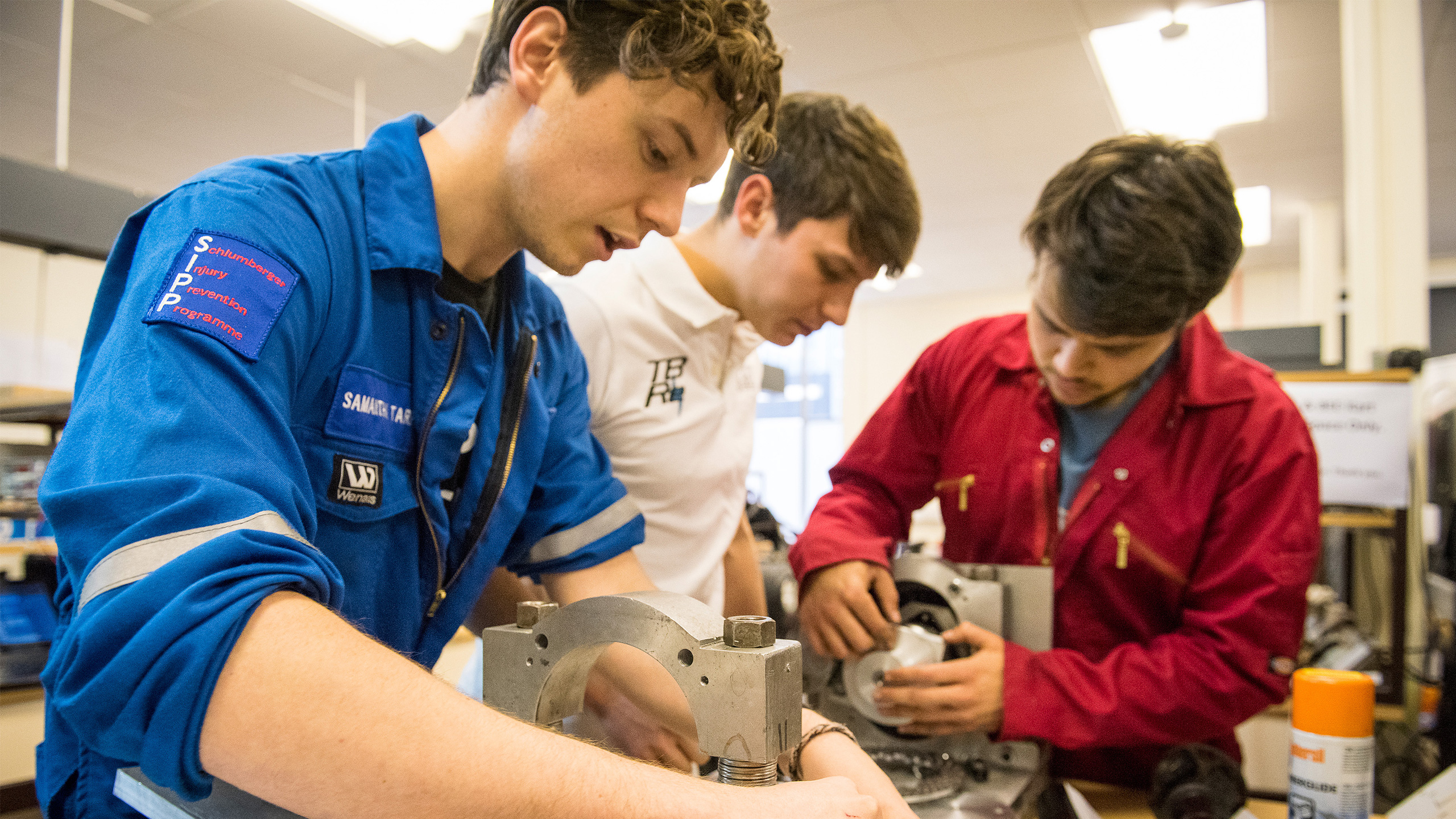 Students work on their Team Bath Racing Electric project in an electrical engineering project lab