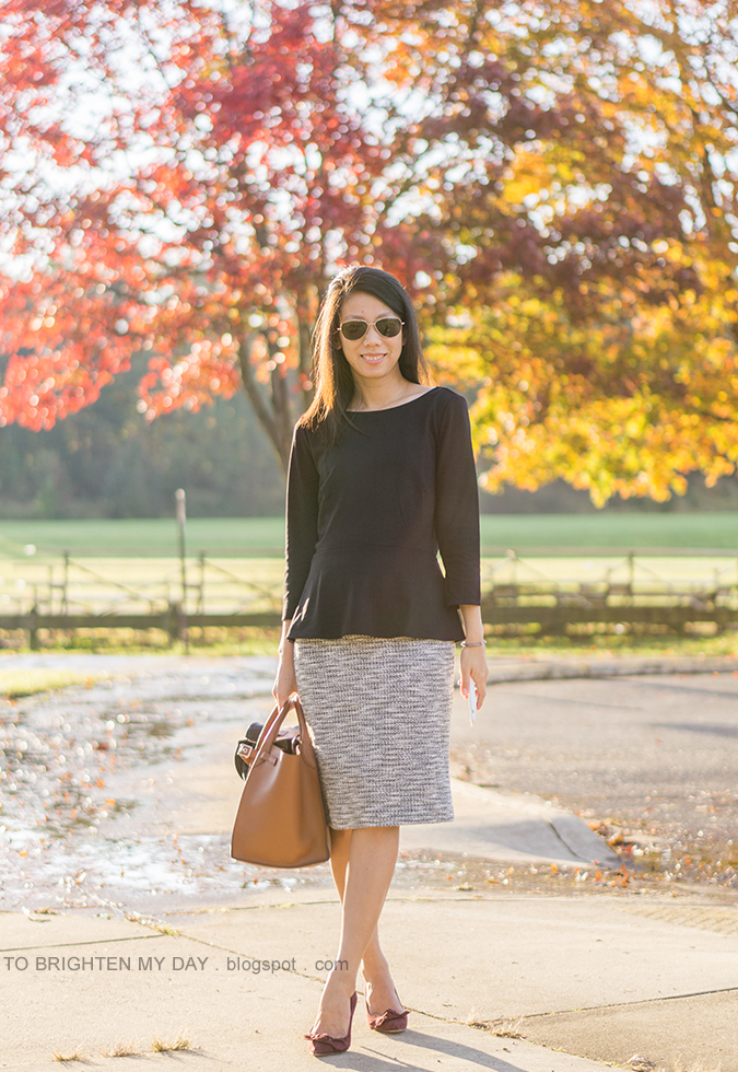 black boatneck top with peplum, marled knit pencil skirt, black leather jacket, brown tote with belt, berry suede pumps with bow