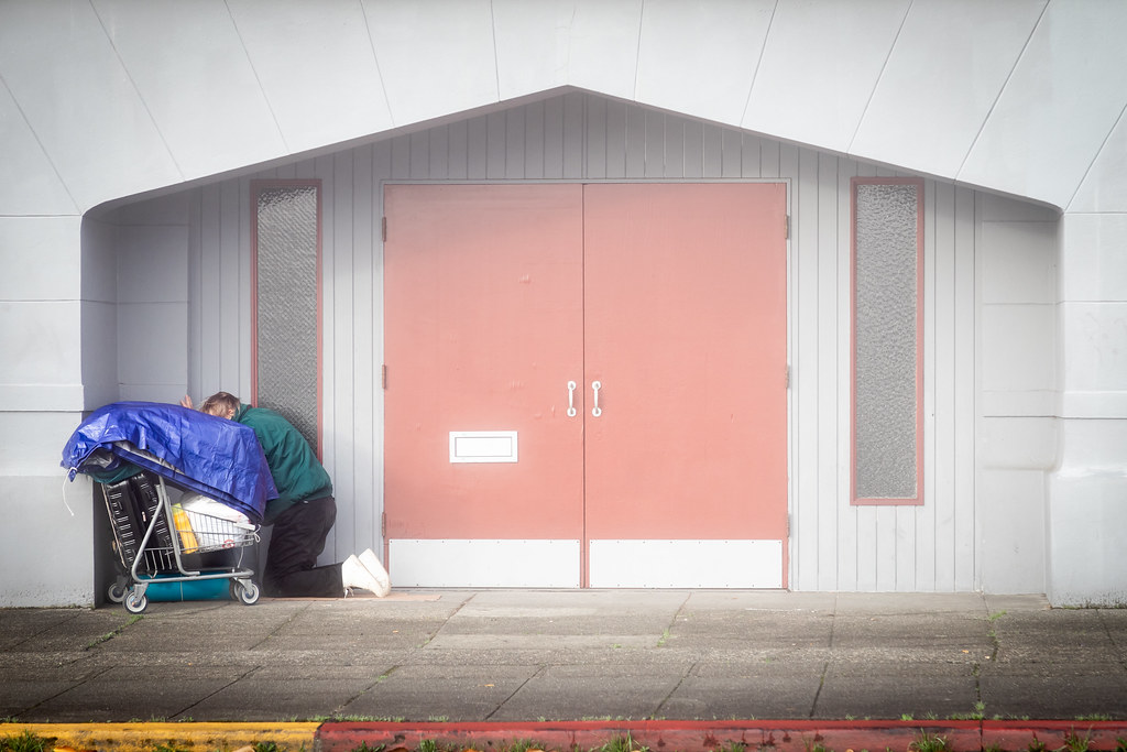 Everett, Washington / USA - 10/27/2018 - Homeless person in the doorway of a church