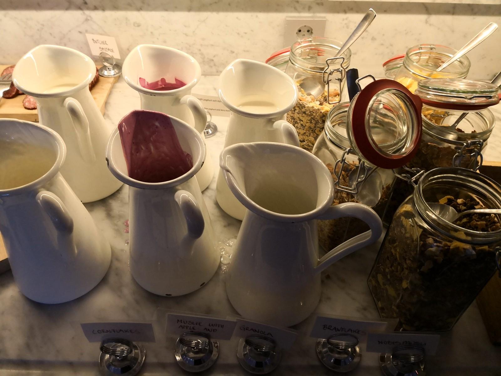 Granola and muesli in jugs