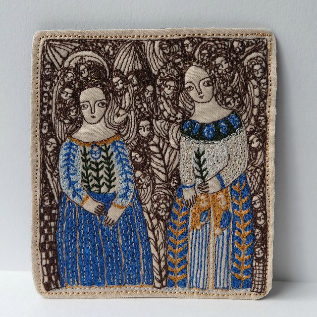 two angelic figures on blue