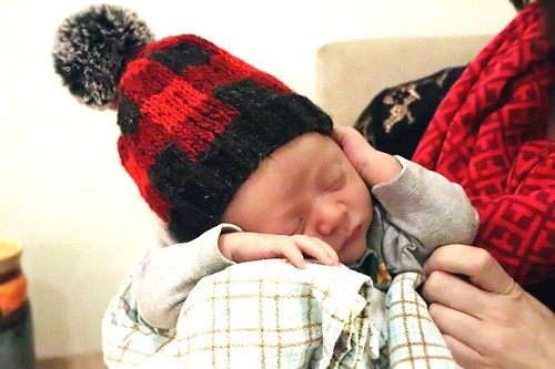 The sweetest baby wearing the littlest of the Yukon Campfire Hats by Liz Sutton that Linda knit!