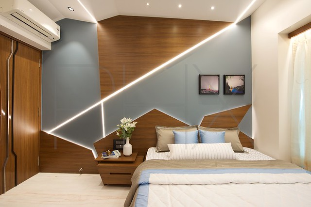 Origami patterned lighting and ceiling in bedroom