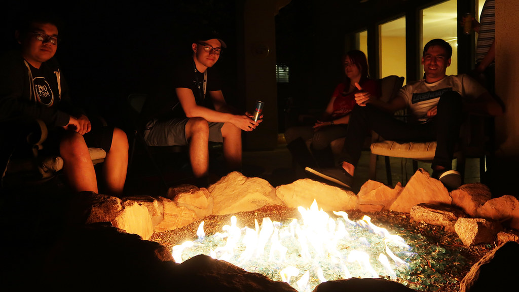Members of Tempo Storm by the fire pit