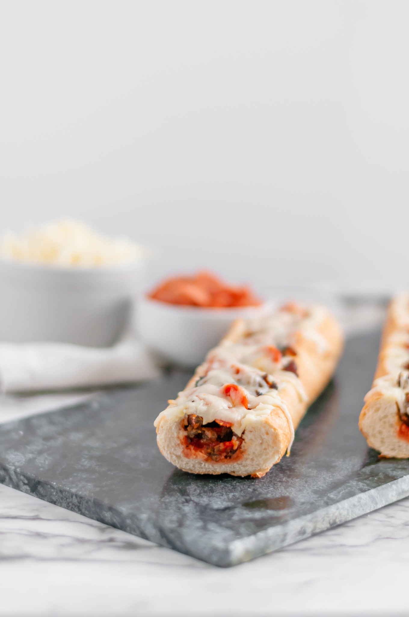 These French Bread Pizza Bites are a great option for the Super Bowl this year. French baguette is hollowed out & stuffed with your favorite pizza toppings.