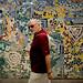 Tourists Walk by the Wall on Pino Suarez por David J. Greer