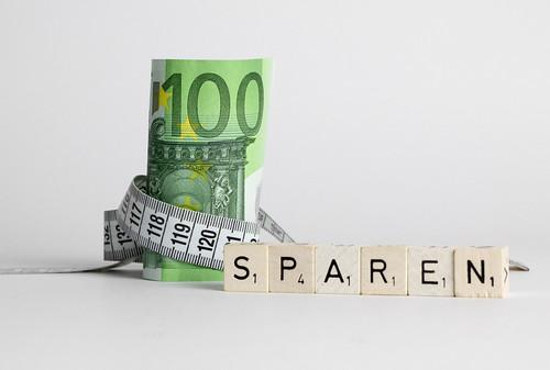 Money shortage concept with German word Sparen