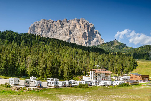 Hotel Sella with on the background the Langkofel (Sasso Lungo), part of the Langkofel Group (Gruppo del Sassolungo)