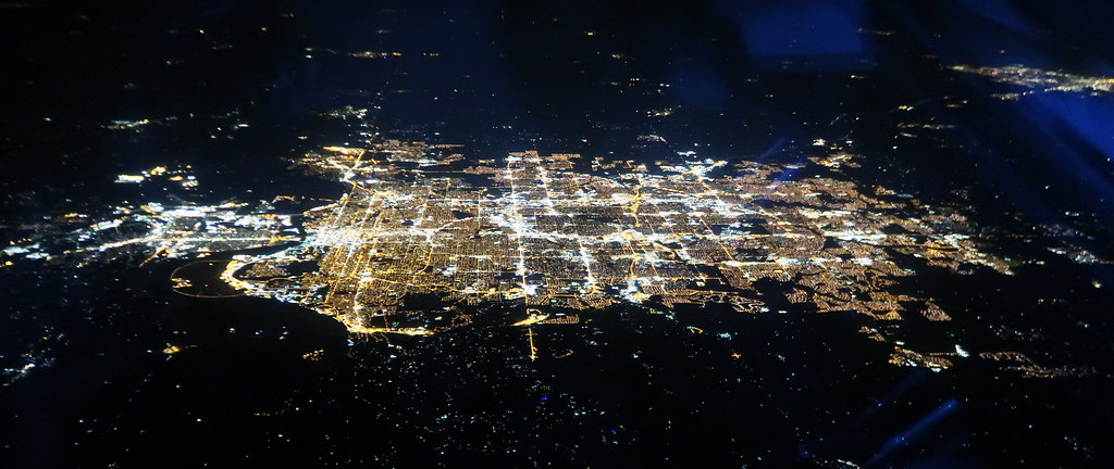 A southward-facing bird's eye view of Omaha, NE from a plane