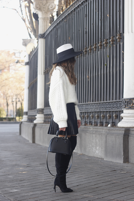 black pleated skirt  white sweater louis vuitton bag street style inspiration 20192