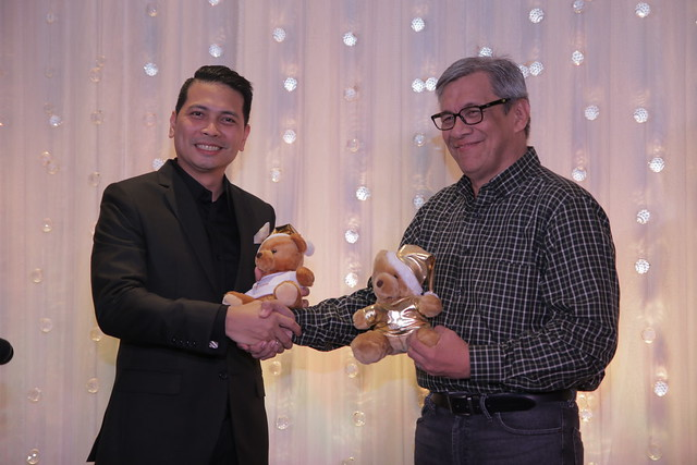 GM Ken Kapulong and Smile Train Project Manager Jun Grimares exchange bears as symbol of partnership (2)