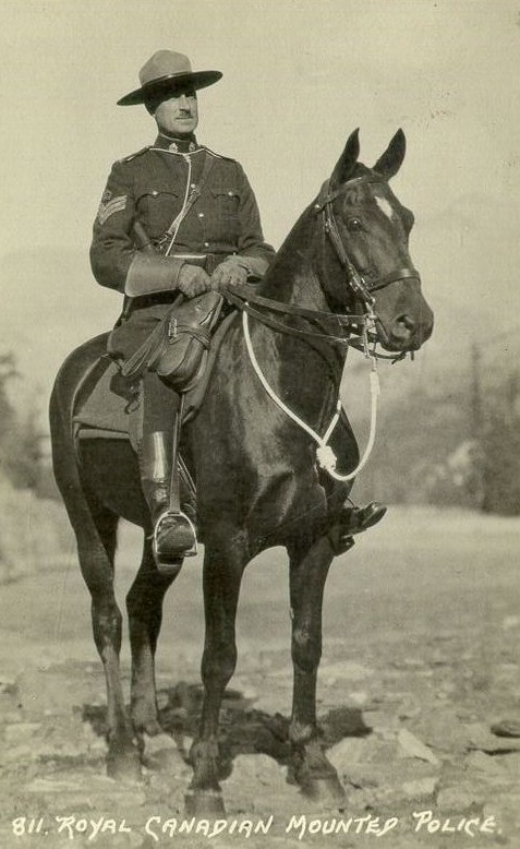 Postcard of a Royal Canadian Mounted Police officer on horseback. Postcard was postmarked in 1935.