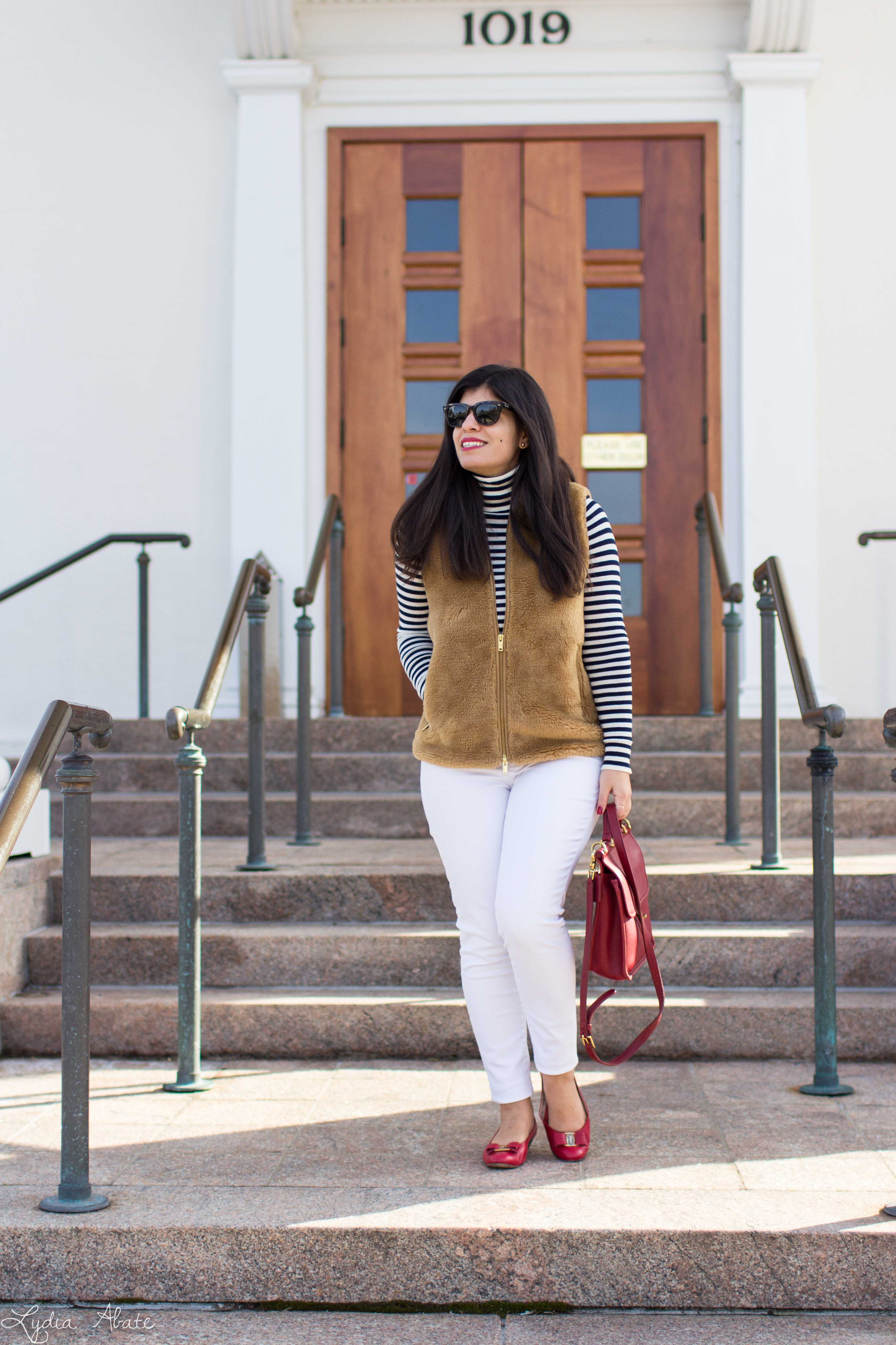 J.Crew plush excursion vest, striped shirt, white jeans, red Ferragamo bow pumps, coach bag-1.jpg