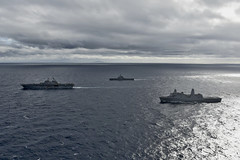 EAST CHINA SEA (Jan. 12, 2019) The amphibious assault ship USS Wasp (LHD 1), Japan Maritime Self-Defense Force amphibious transport dock ship JS Kunisaki (LST 4003), and amphibious transport dock ship USS Green Bay (LPD 20), right, transit in formation during a cooperative deployment. Wasp, flagship of Wasp Amphibious Ready Group, is operating in the Indo-Pacific region to enhance interoperability with partners and serve as a ready-response force for any type of contingency. (U.S. Navy photo by Mass Communication Specialist 1st Class Daniel Barker)