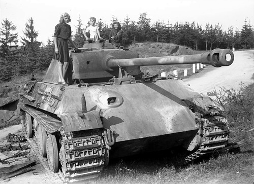 Children posing on a Wehrmacht Panther Pz. Kpfw. V Ausf. G, abandoned near Cimer in Czechoslovakia 1945.