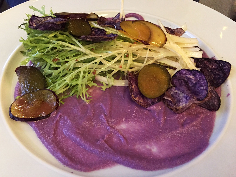 Frisée salad with purple potato, plum, and Monschau mustard