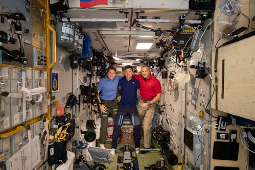 Expedition 58 crew members gather inside the Zvezda service module