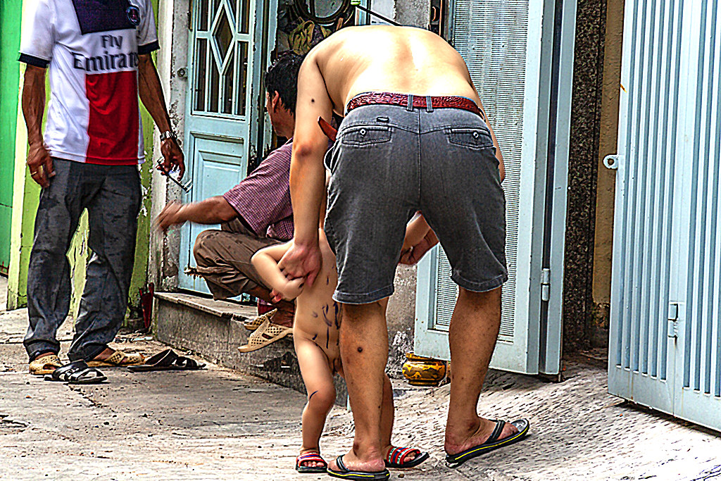 Father and son in District 10 alley--Saigon