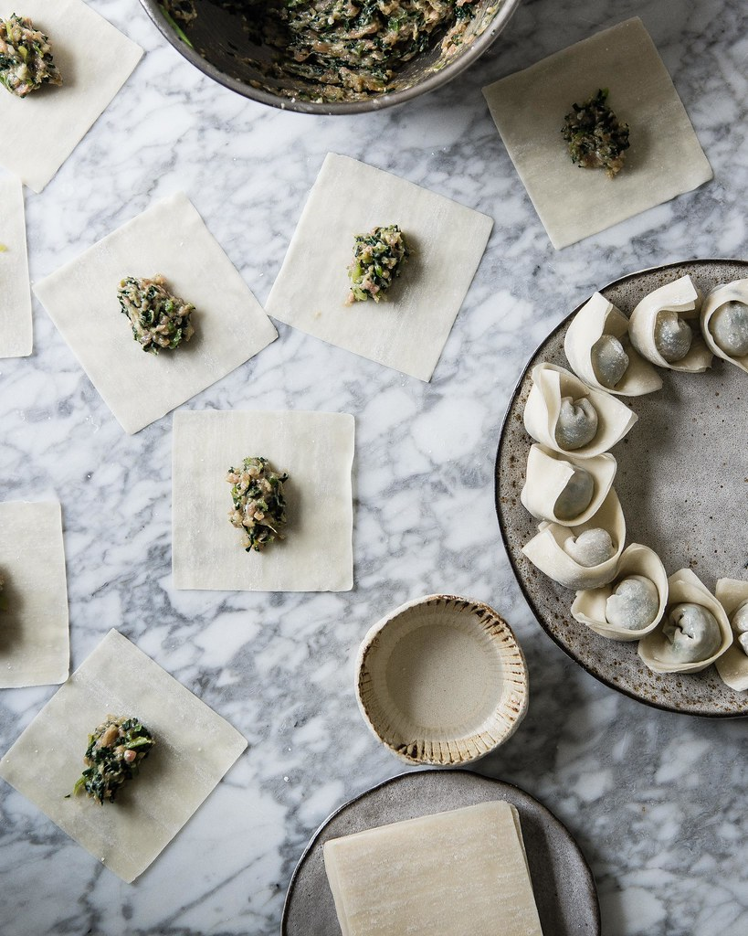 collard wontons | two red bowls