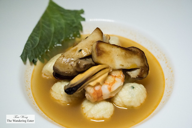 Ricotta cheese gnocchi with seafood broth, cepes mushrooms and shiso
