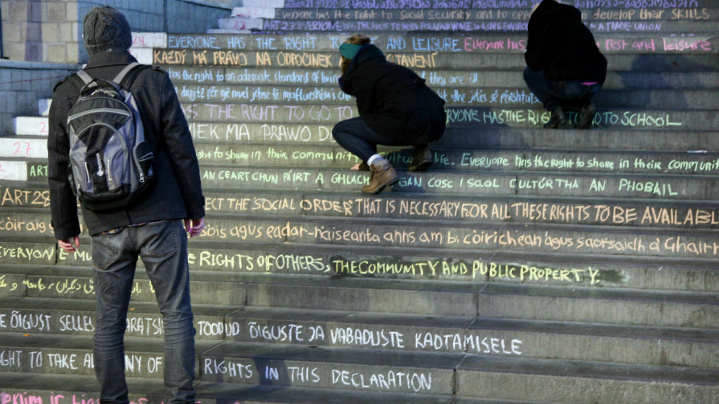 Human rights declaration chalked on steps