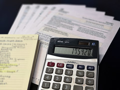A calculator is pictured alongside a number ox tax forms and a notebook, ahead of the self assessment deadline day on the 31st January 2019