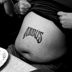 He went to photography school and all he got was this lousy tattoo