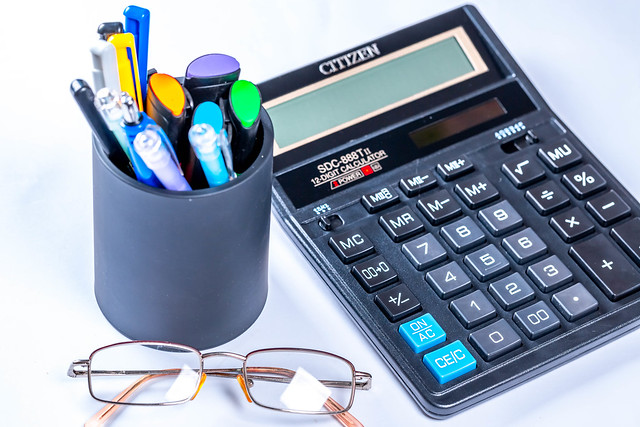 Glasses, calculator and pens