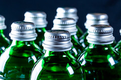 Green glass bottles with lids