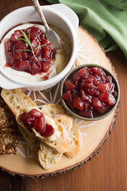 Crostini Topped with Baked Brie and Wine-Poached Pear Compote