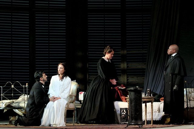 Charles Castronovo as Alfredo Germont, Ermonela Jaho as Violetta Valéry, Catherine Carby as Annina and Simon Shibambu as Doctor Grenvil in La traviata, The Royal Opera © 2019 ROH. Photographed by Catherine Ashmore