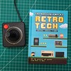 My copy of The Nostalgia Nerd's Retro Tech book actually arrived last Tuesday as scheduled but I wanted to retrieve a proper accessory for it before posting a pic. It's a really good compendium of the first 25 or so years of console and computer gaming an