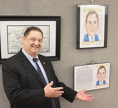 Rep. Bolinsky pictured with a leadership portrait in the concourse of the LOB.